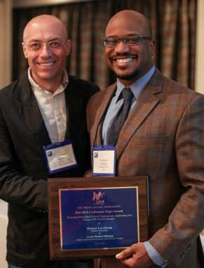 Jonathan Davies (DeMontfort Univ.-UK)-on the left, presents 2013 Best Conference Paper Award to Michael Leo Owens (Emory Univ.)