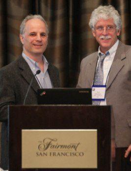 Alex Schwartz (New School Univ.)-on the left, presents 2013 Best Published Paper in the <em>Journal of Urban Affairs</em> Award to Paul Schumaker (Univ. of Kansas)