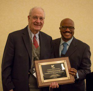 Clarence Stone (left) receives the Contribution to the Field of Urban Affairs Award from Michael Leo Owens (Emory Univ)